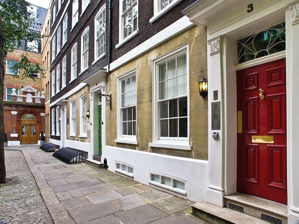 building property sidewalk neighbourhood Architecture residential area home door way curb stone