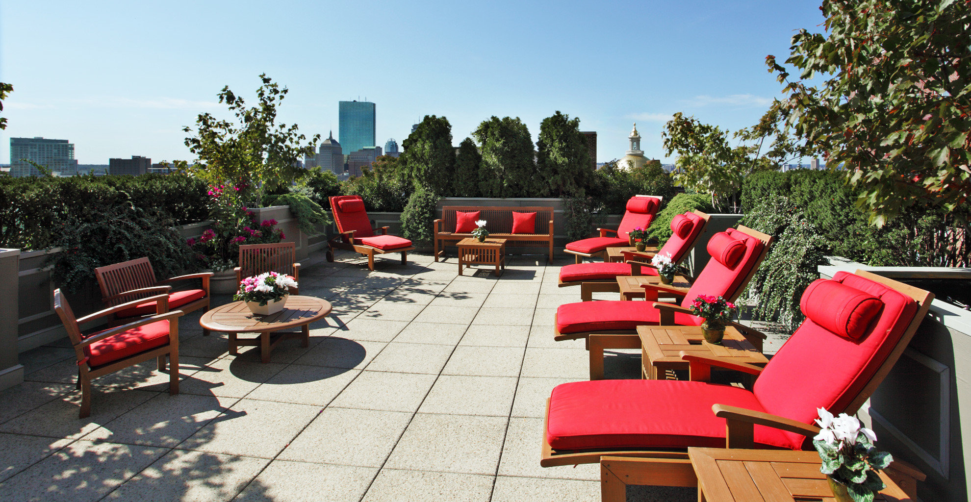 Architecture Buildings Business Exterior Grounds Historic Landmarks Lounge Luxury Modern Outdoor Activities Outdoors Romantic Rooftop Scenic views tree sky leisure chair property red Resort backyard cottage arranged