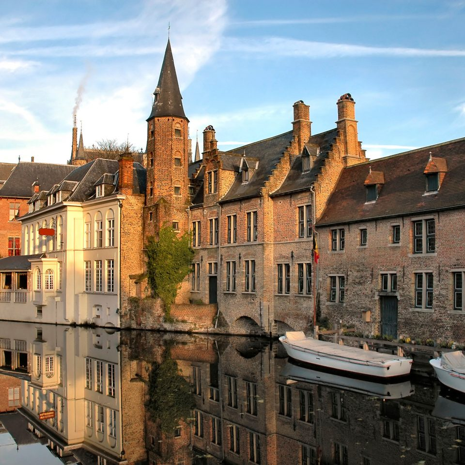 Architecture Buildings Cultural Exterior Romantic Waterfront sky building Town castle landmark City château old cityscape waterway Canal water castle middle ages autumn town square palace day
