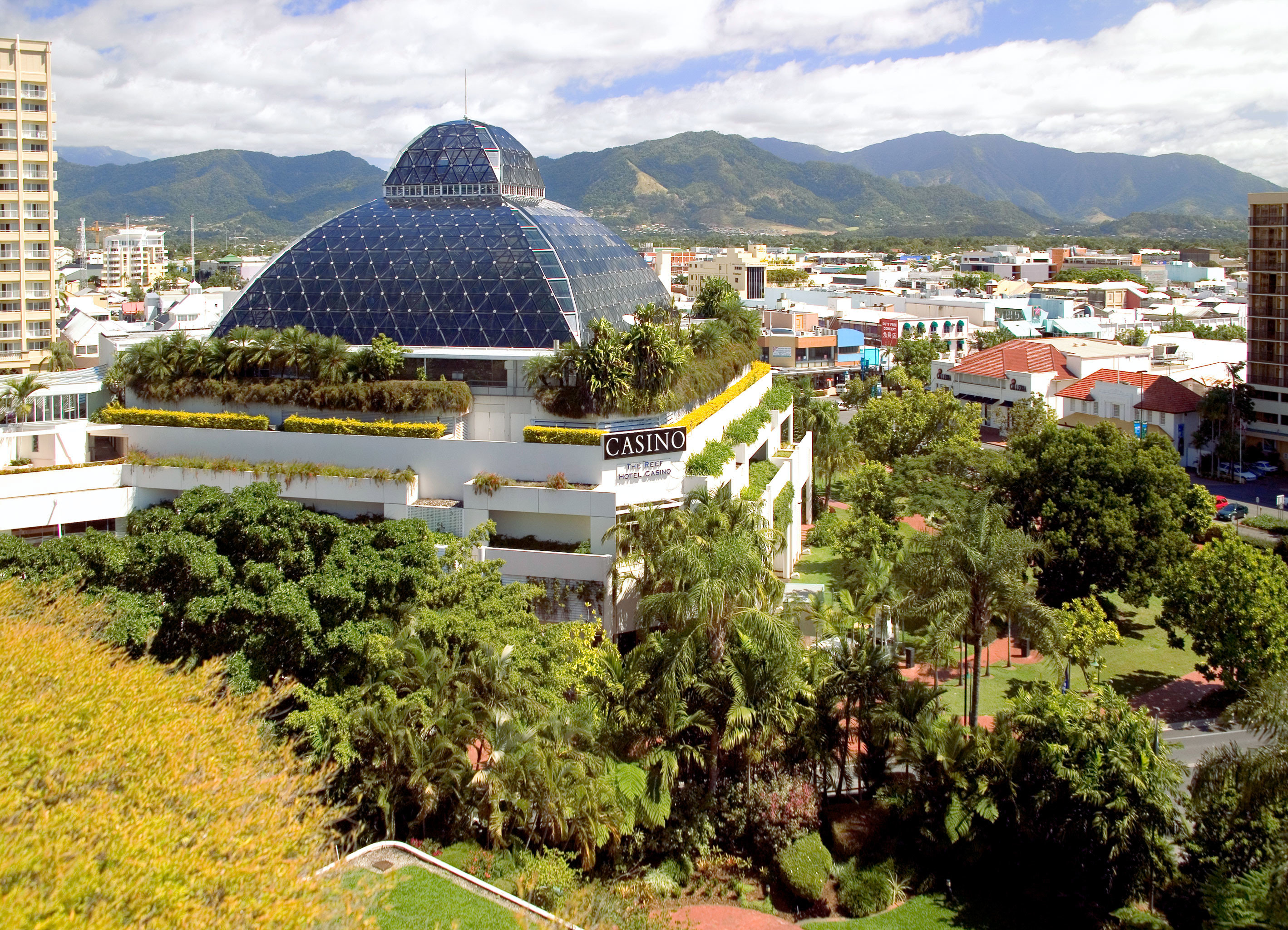 Architecture Buildings Casino Exterior Resort tree sky grass building mountain Town Village dome Garden day