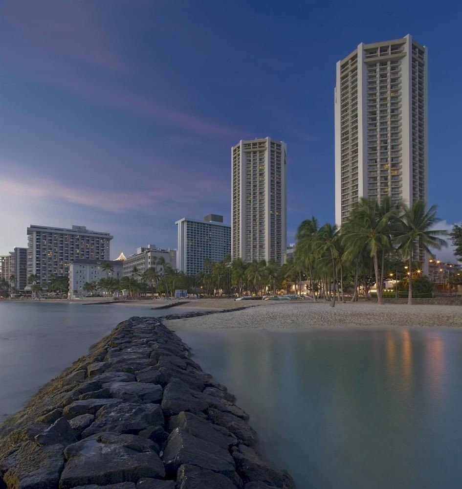 Architecture Buildings Exterior Resort sky water skyscraper River landmark skyline tower block City horizon cityscape tower Coast Downtown dusk evening Sea Lake tall overlooking stone distance