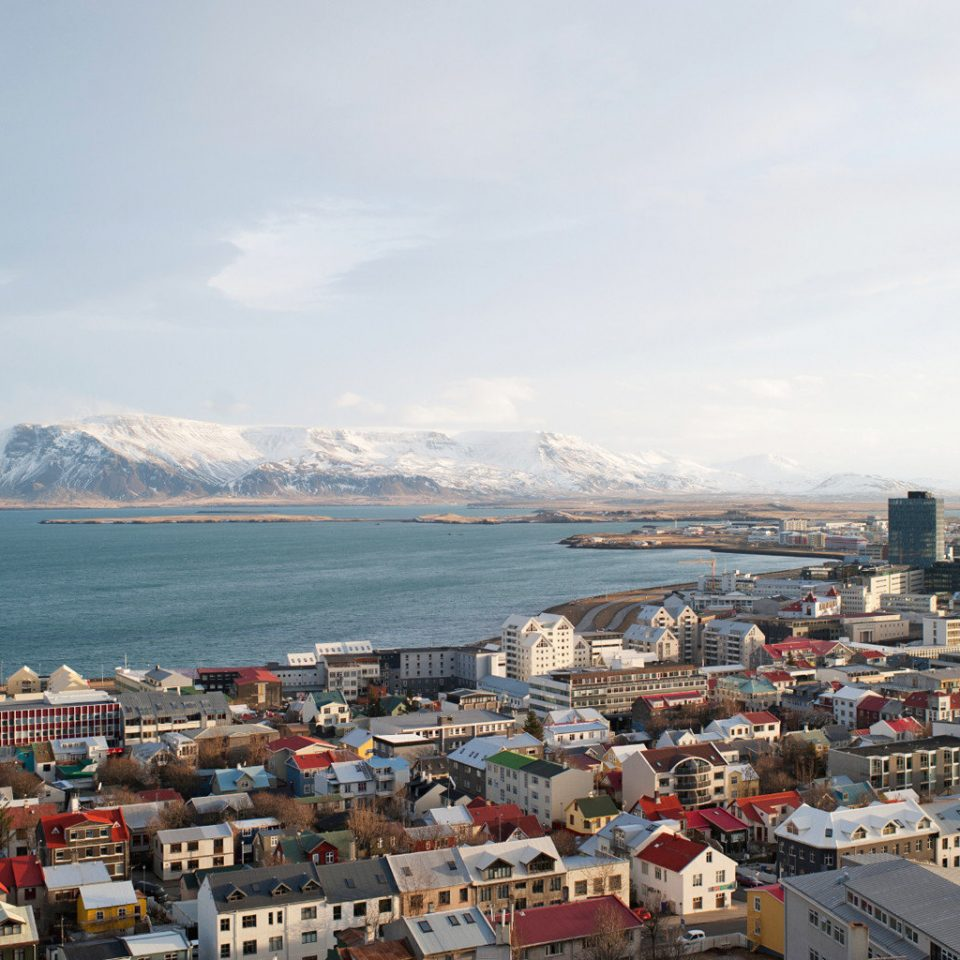 Architecture Buildings City Drink Eat Entertainment Hotels Iceland Landmarks Monuments Mountains Museums Nightlife Scenic views Shop Trip Ideas sky Town Sea Coast scene mountain Harbor cityscape horizon port panorama aerial photography skyline
