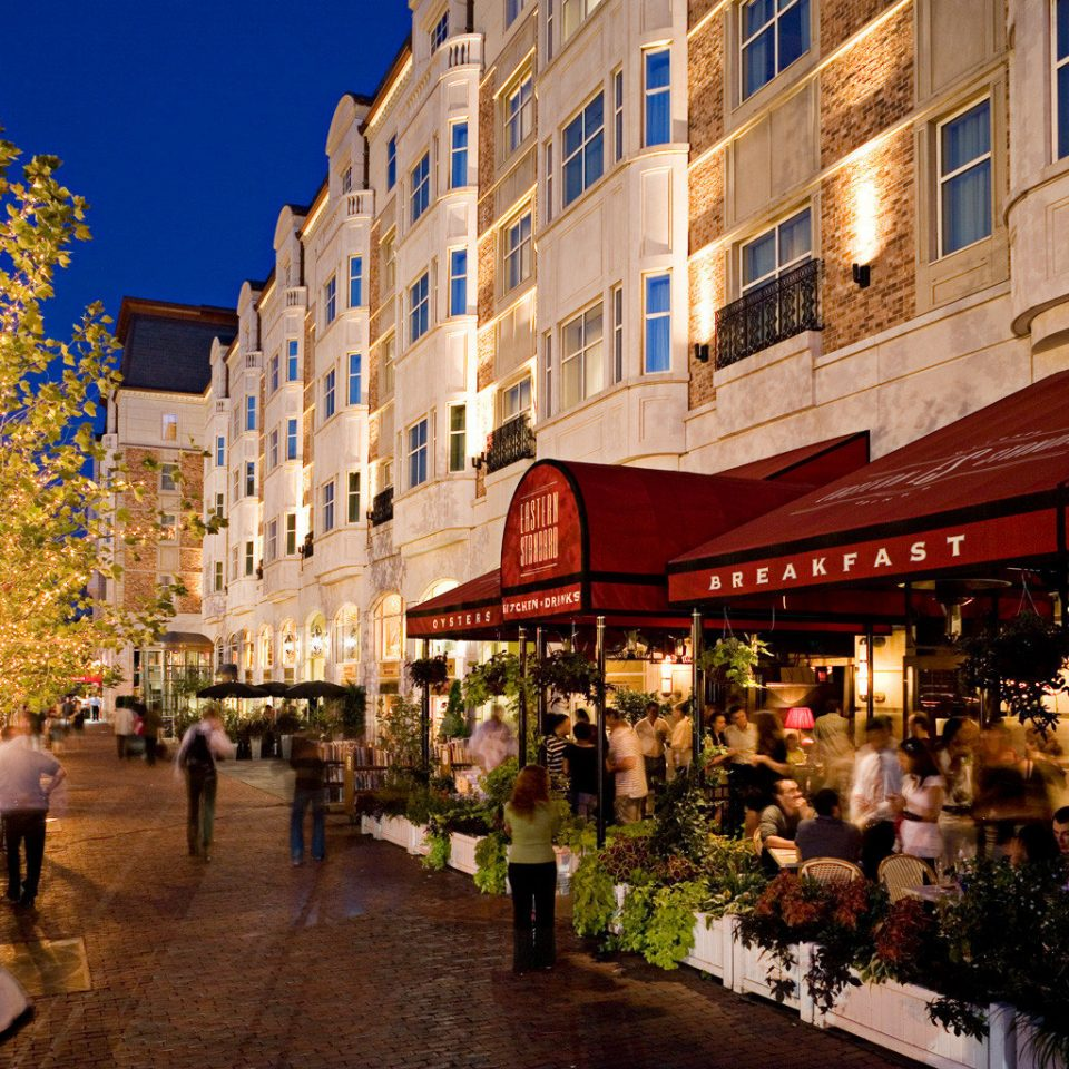 Architecture Buildings City Dining Shop Waterfront building road Town neighbourhood public space street night Downtown plaza evening cityscape infrastructure town square way apartment building crowd
