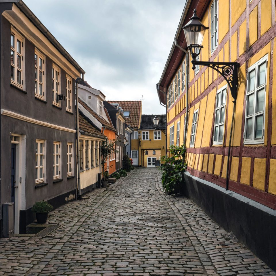 Architecture Buildings Exterior Modern Outdoors sky building road Town way neighbourhood street lane City alley residential area sidewalk infrastructure waterway cityscape stone