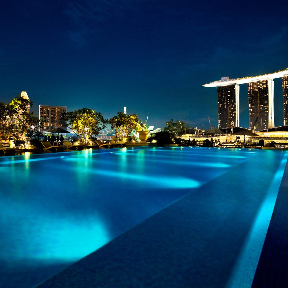 Architecture Buildings City Exterior Lounge Pool Waterfront sky water night scene landmark light horizon swimming pool cityscape evening dusk skyline Harbor distance