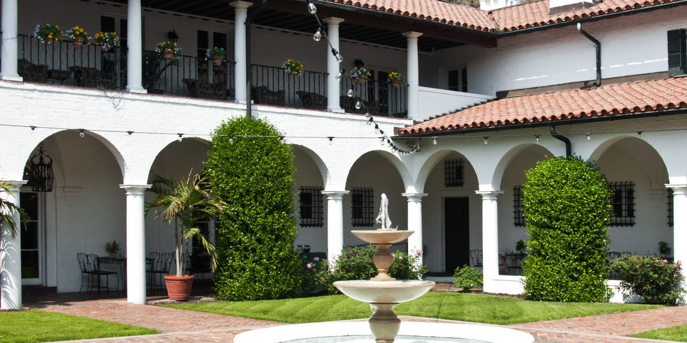 Buildings Classic Courtyard Exterior Historic building sky grass house property Architecture old mansion Villa hacienda home palace stone colonnade