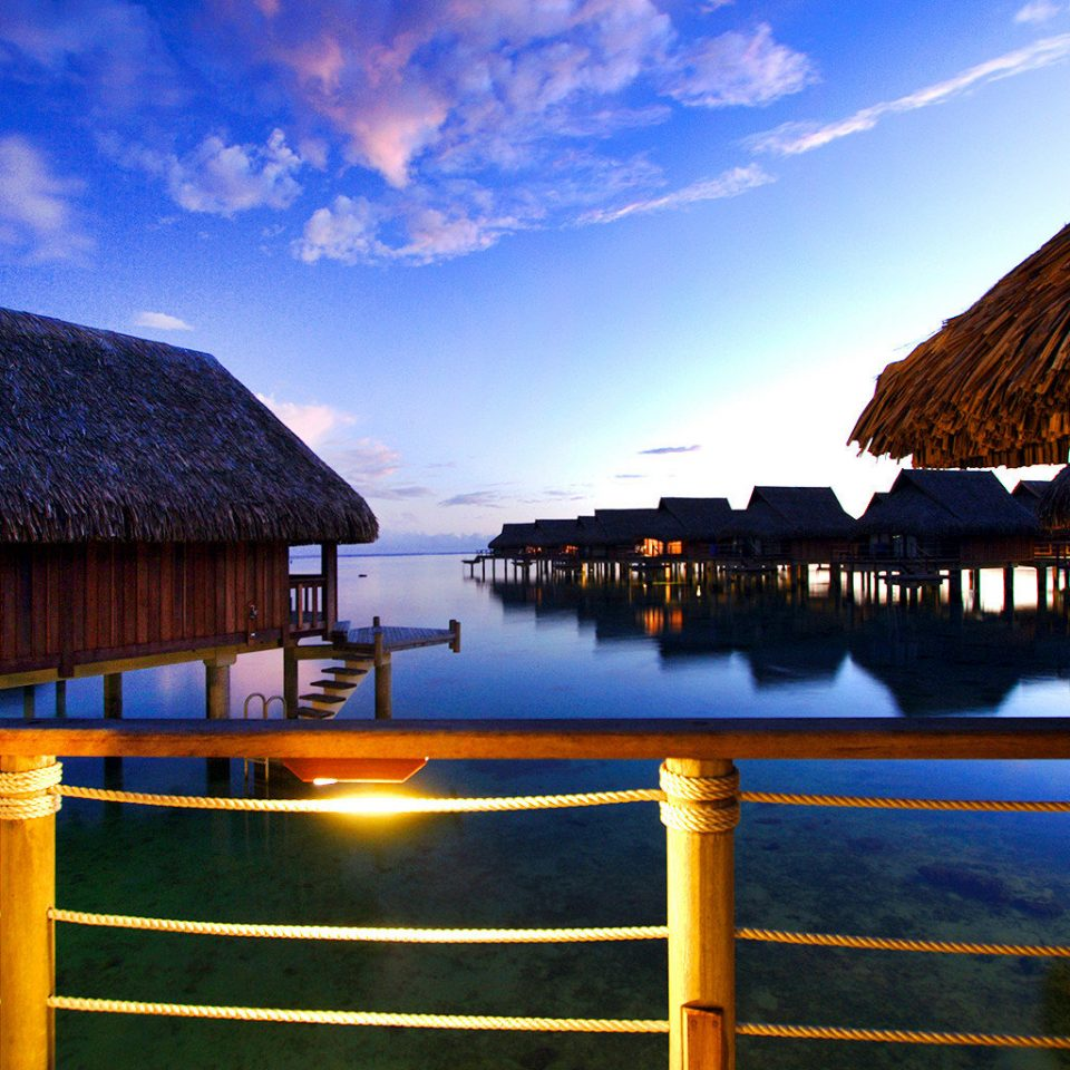 Architecture Buildings Exterior Hotels Luxury Overwater Bungalow Resort Scenic views sky water umbrella Sea Ocean Sunset evening house night dusk morning Coast sunlight