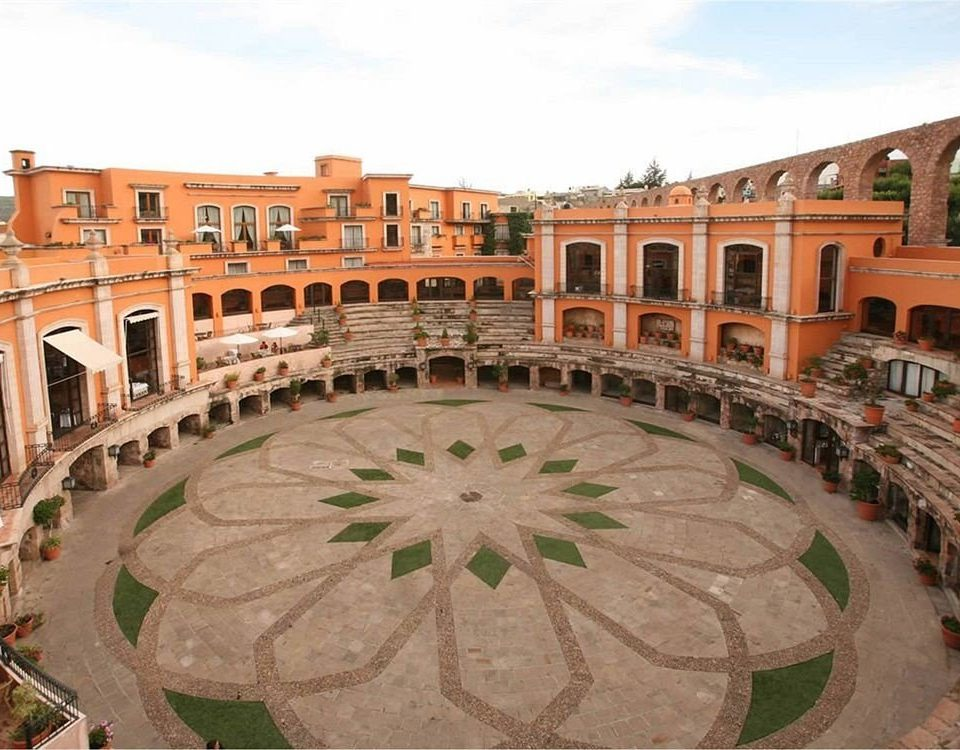 Architecture Buildings Elegant Exterior Historic Rustic sky amphitheatre building plaza historic site landmark town square palace ancient rome Courtyard green bullring ancient history arch colonnade