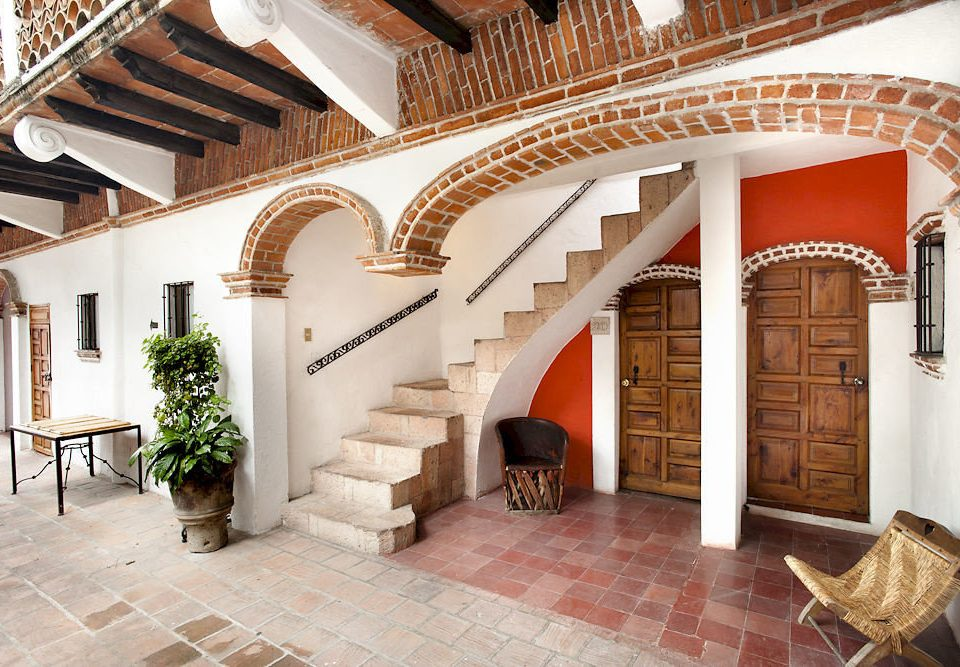 Architecture Buildings Exterior Landmarks Scenic views building property Fireplace home hacienda Villa arch mansion Courtyard flooring rug stone tile tiled