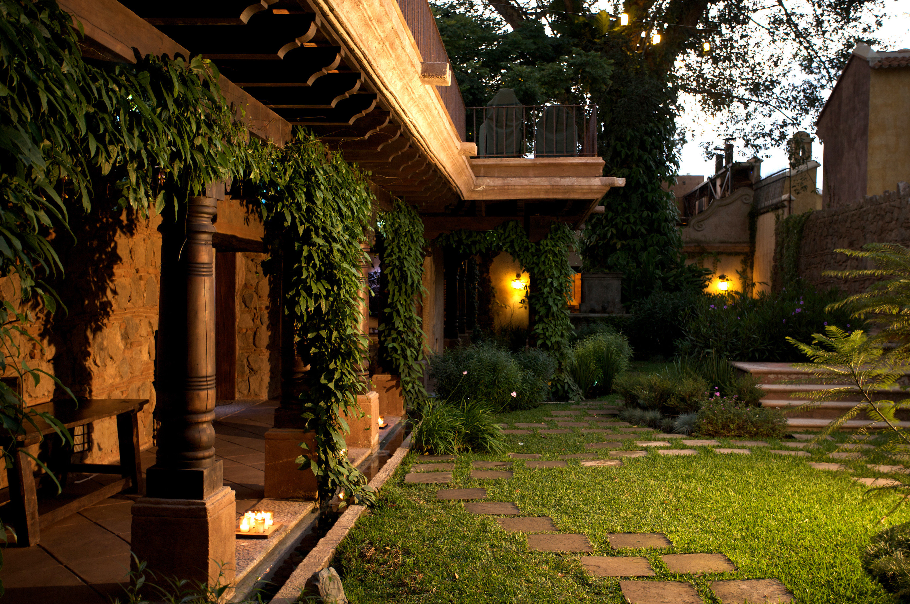 Architecture Buildings Exterior Grounds Patio tree grass property house Courtyard landscape lighting sidewalk street home backyard yard lighting mansion Garden screenshot Villa cottage outdoor structure plant residential stone curb