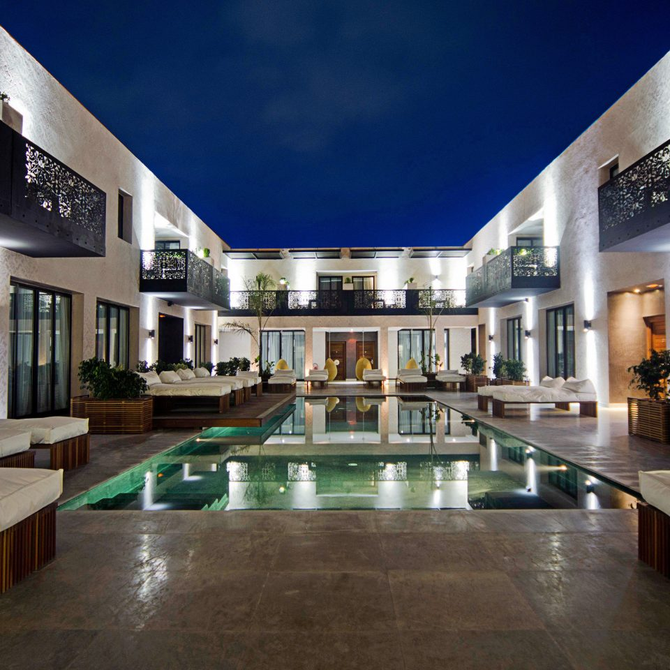 Architecture Buildings Exterior Lounge Nightlife Outdoors Pool Resort property Lobby building condominium plaza home mansion swimming pool Courtyard convention center