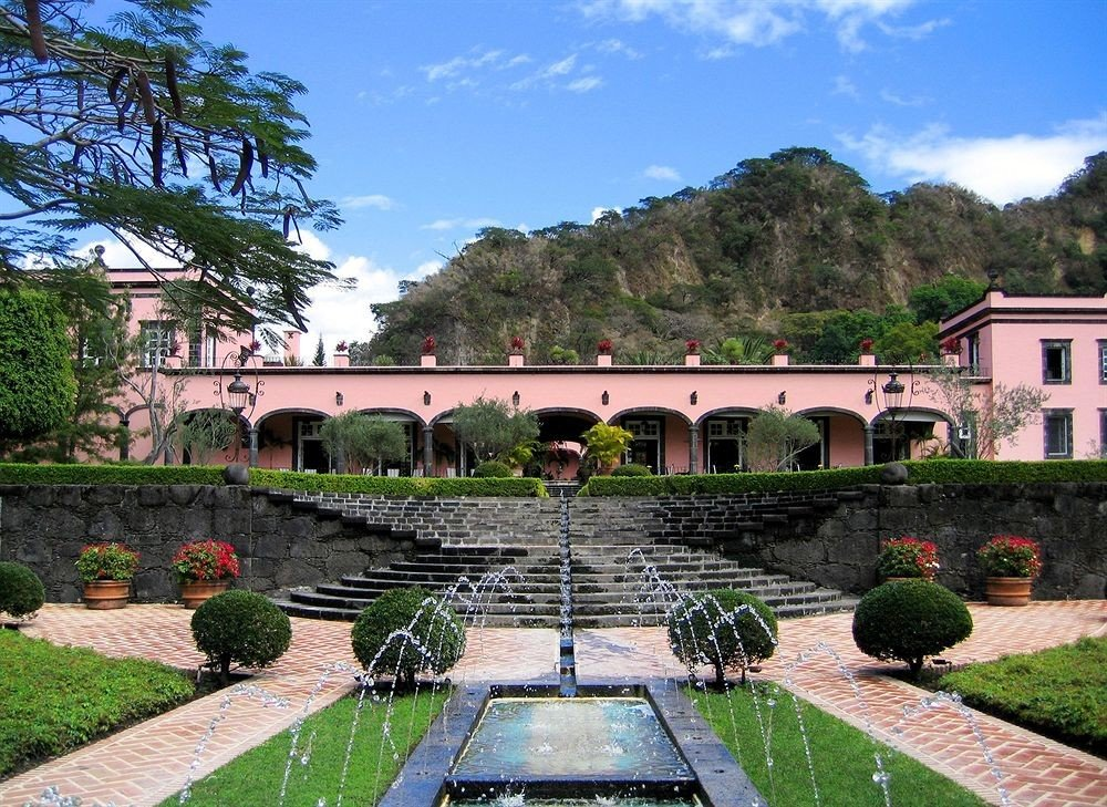 Architecture Buildings Garden Grounds Mountains Scenic views grass tree sky property building flower house green home Courtyard brick mansion Villa hacienda palace stone walkway Resort colonnade