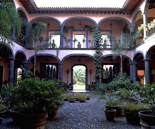 Architecture Buildings Garden Grounds Mountains Scenic views building property Courtyard house mansion hacienda Villa Resort home plant palace stone court colonnade