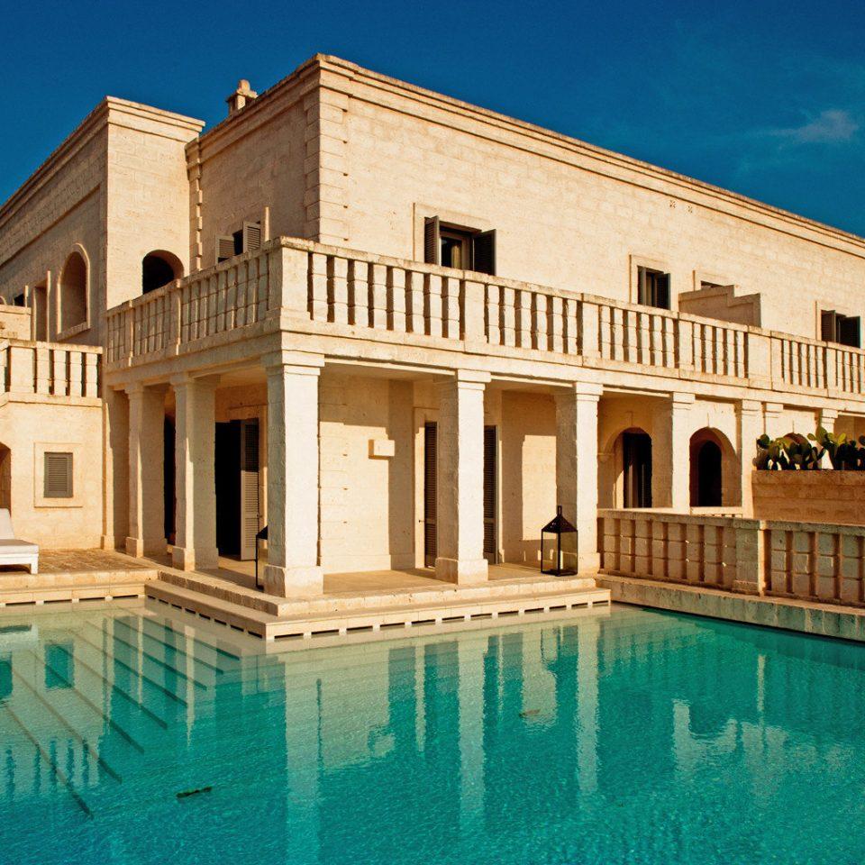 Architecture Buildings Cultural Elegant Exterior Patio Pool building property house Villa swimming pool palace mansion Resort hacienda condominium