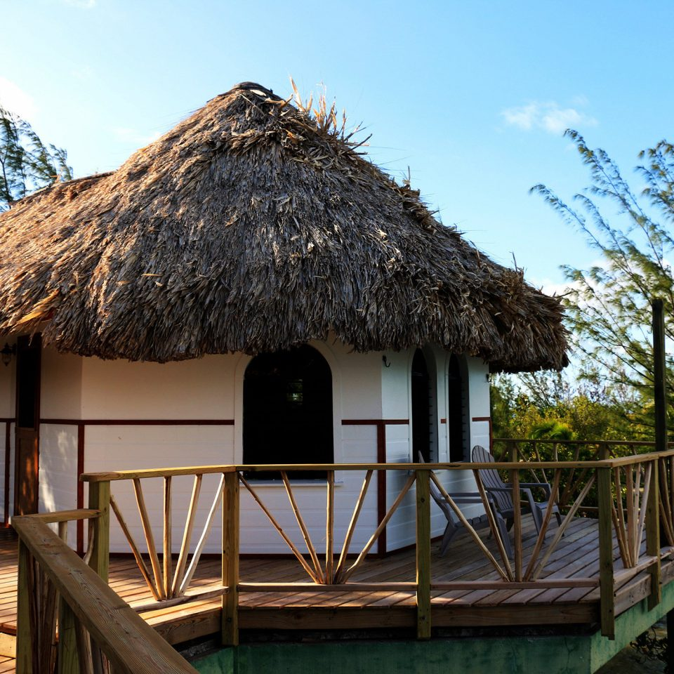 Architecture Buildings Deck Eco Exterior Grounds Resort tree sky hut house cottage home thatching roof Village boathouse