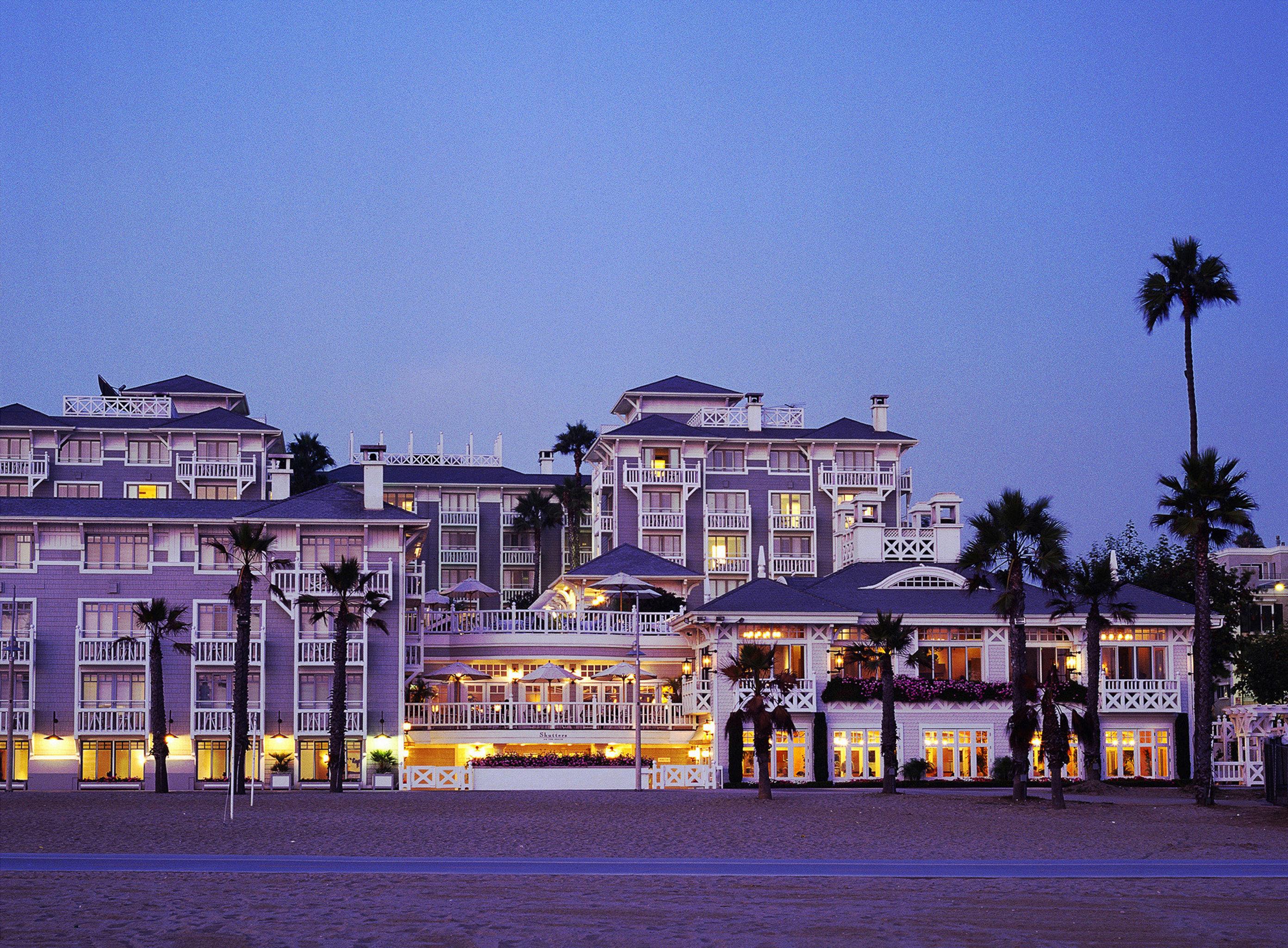 Architecture Buildings Elegant Hotels sky Town landmark night cityscape evening Downtown dusk palace vehicle