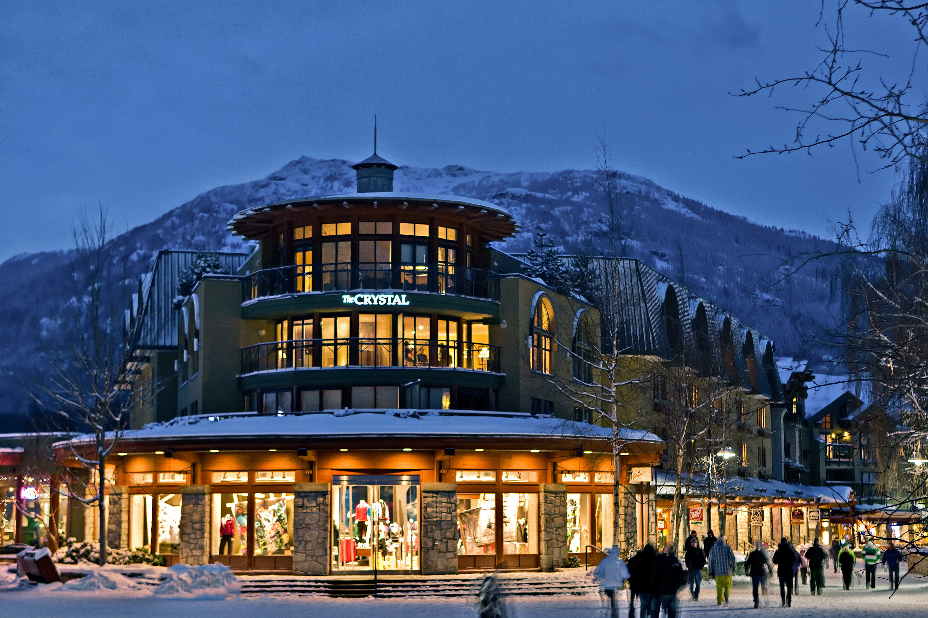 Architecture Buildings Exterior Mountains Outdoor Activities Scenic views Ski sky snow Town landmark Winter night evening Resort Downtown cityscape ice rink traveling