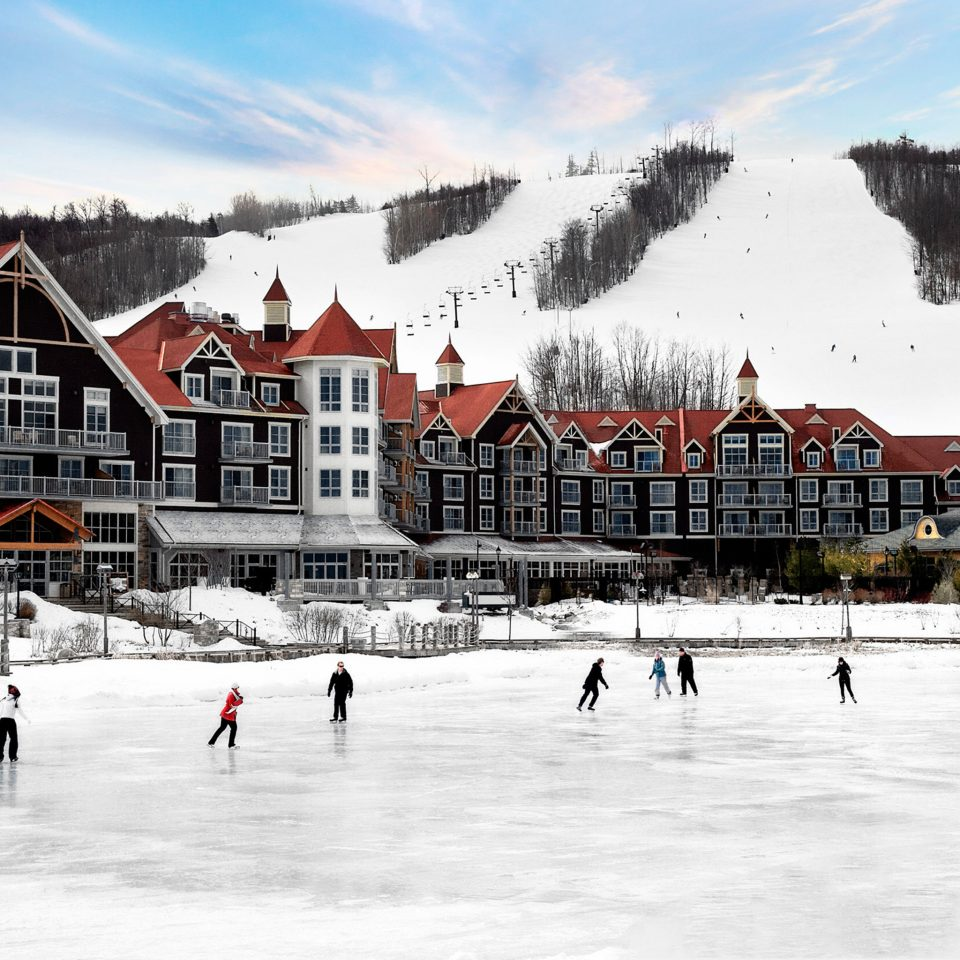 Architecture Buildings Exterior Family Outdoor Activities Resort Scenic views Ski sky snow skiing rink Winter weather building mountain season ski equipment ice rink group piste winter sport ice slope ski slope