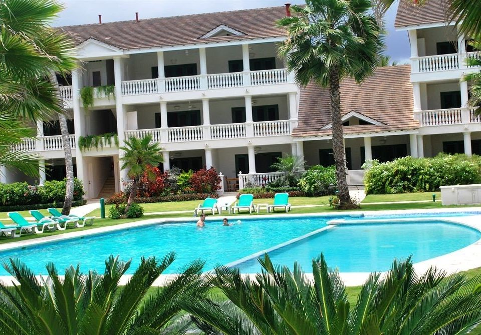 Architecture Buildings Exterior Lounge Luxury Modern Pool tree building Resort swimming pool plant condominium property leisure home Villa backyard mansion blue Garden colorful bushes