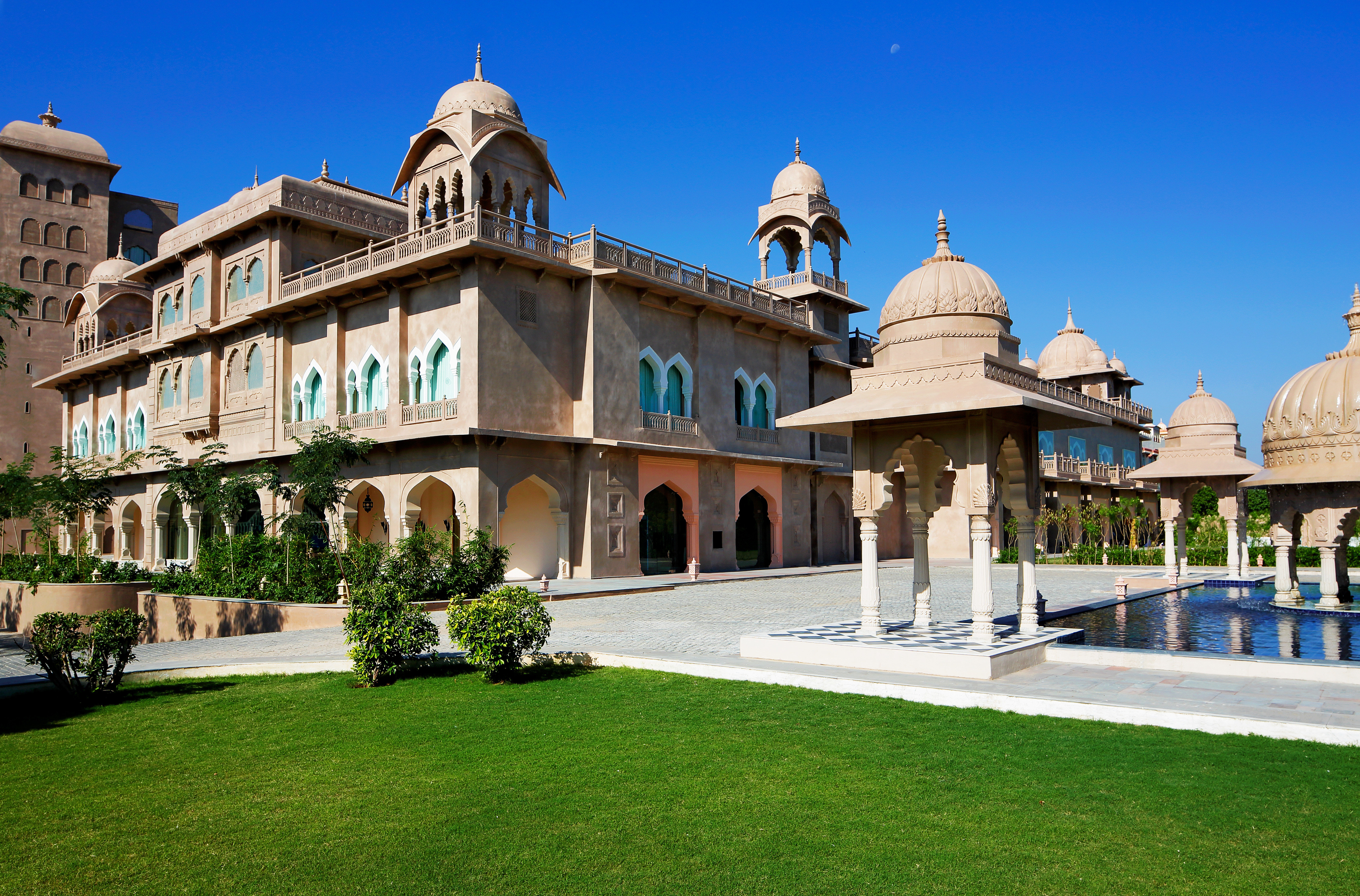 Architecture Buildings Exterior Garden Grounds Outdoors Pool grass sky building landmark Town palace plaza neighbourhood town square mansion château government building stone