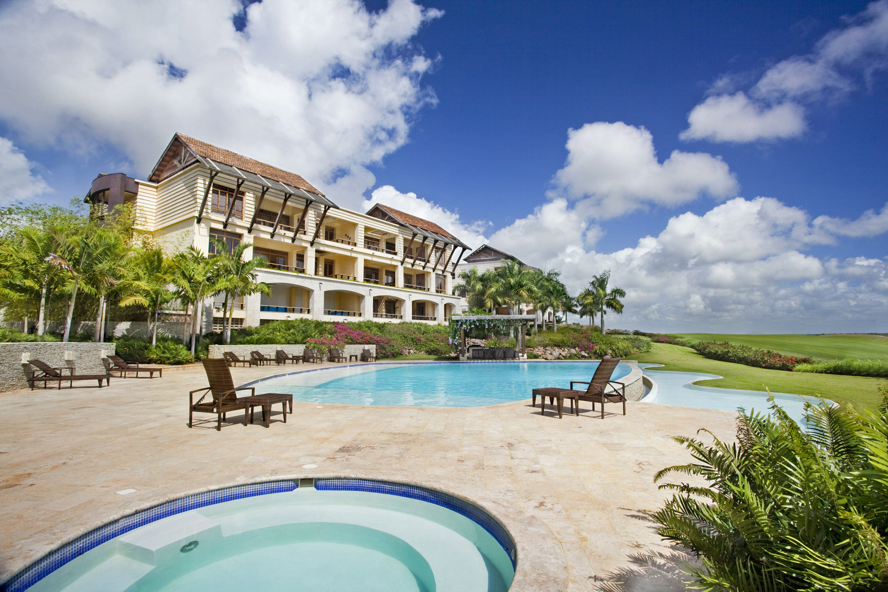 Architecture Buildings Exterior Golf Grounds Play Pool sky ground leisure swimming pool property Resort caribbean Villa Lagoon Sea condominium shore sandy day