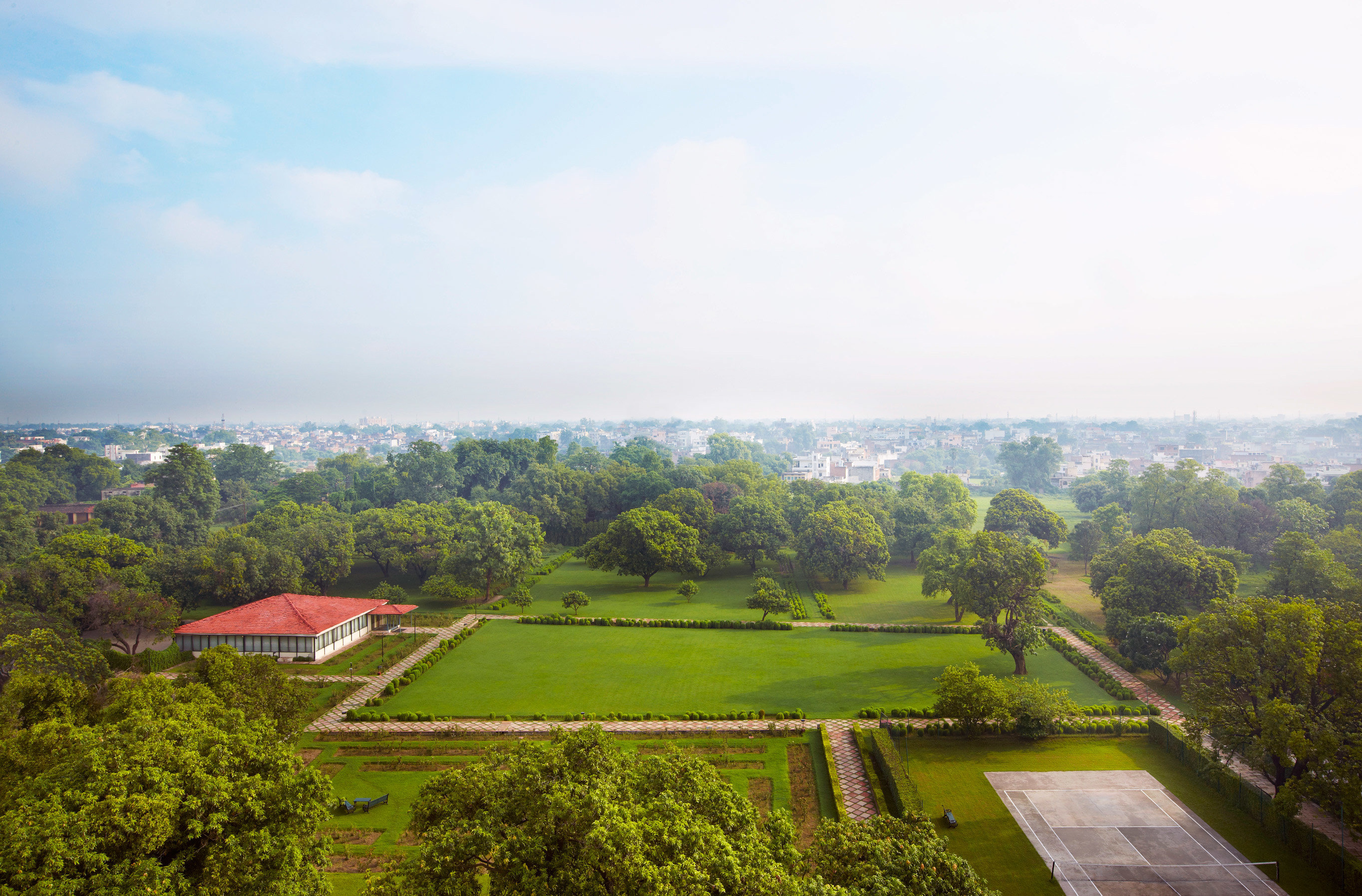 Architecture Buildings Exterior Grounds Outdoors Scenic views tree grass sky structure hill sport venue green field rural area agriculture aerial photography landscape lush way road surrounded hillside highland