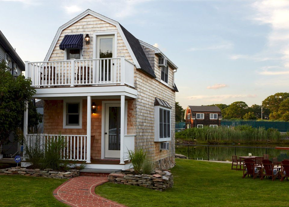 Architecture Buildings Exterior Inn grass sky house building property home siding residential area cottage farmhouse backyard outdoor structure porch lawn suburb mansion old stone
