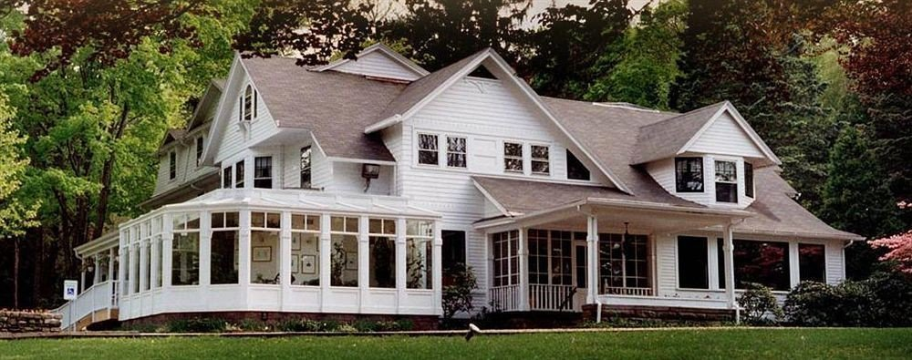 Architecture Buildings Exterior Inn tree building house grass home siding property cottage farmhouse residential historic house mansion residential area manor house porch log cabin old lawn outdoor structure roof