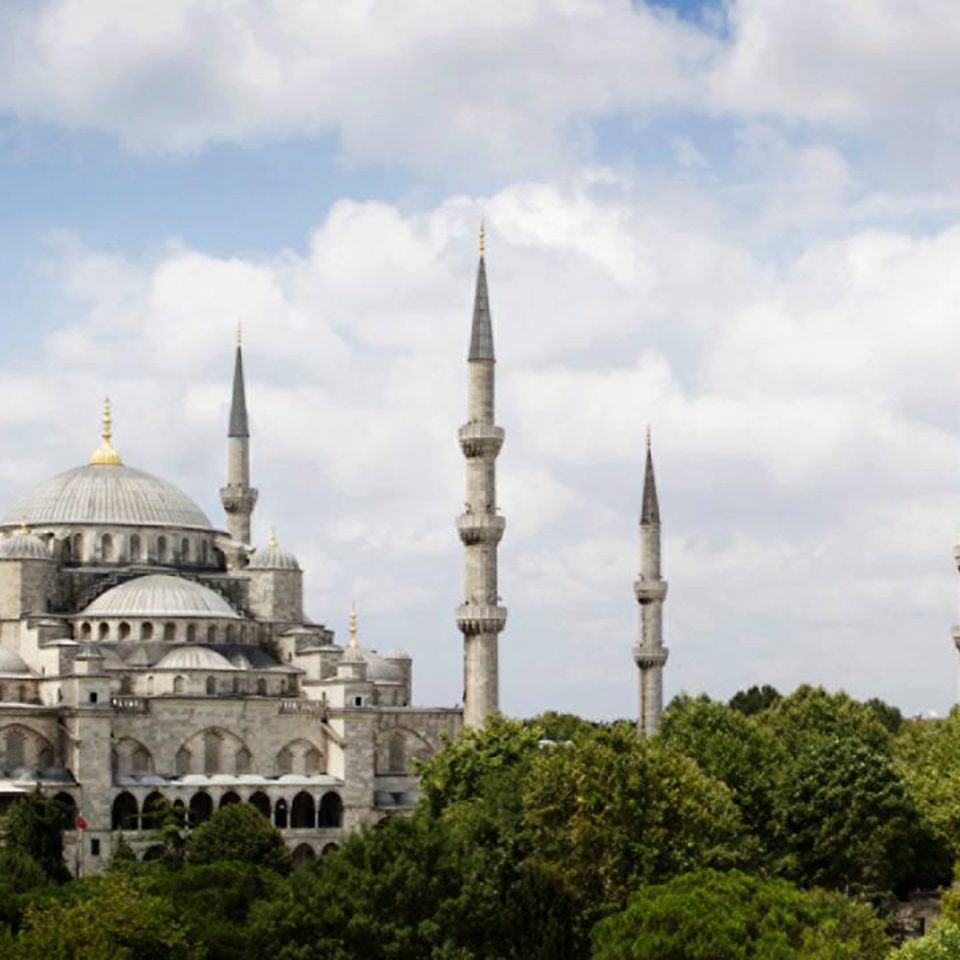 Architecture Buildings Exterior Landmarks sky tree building mosque historic site landmark place of worship spire day