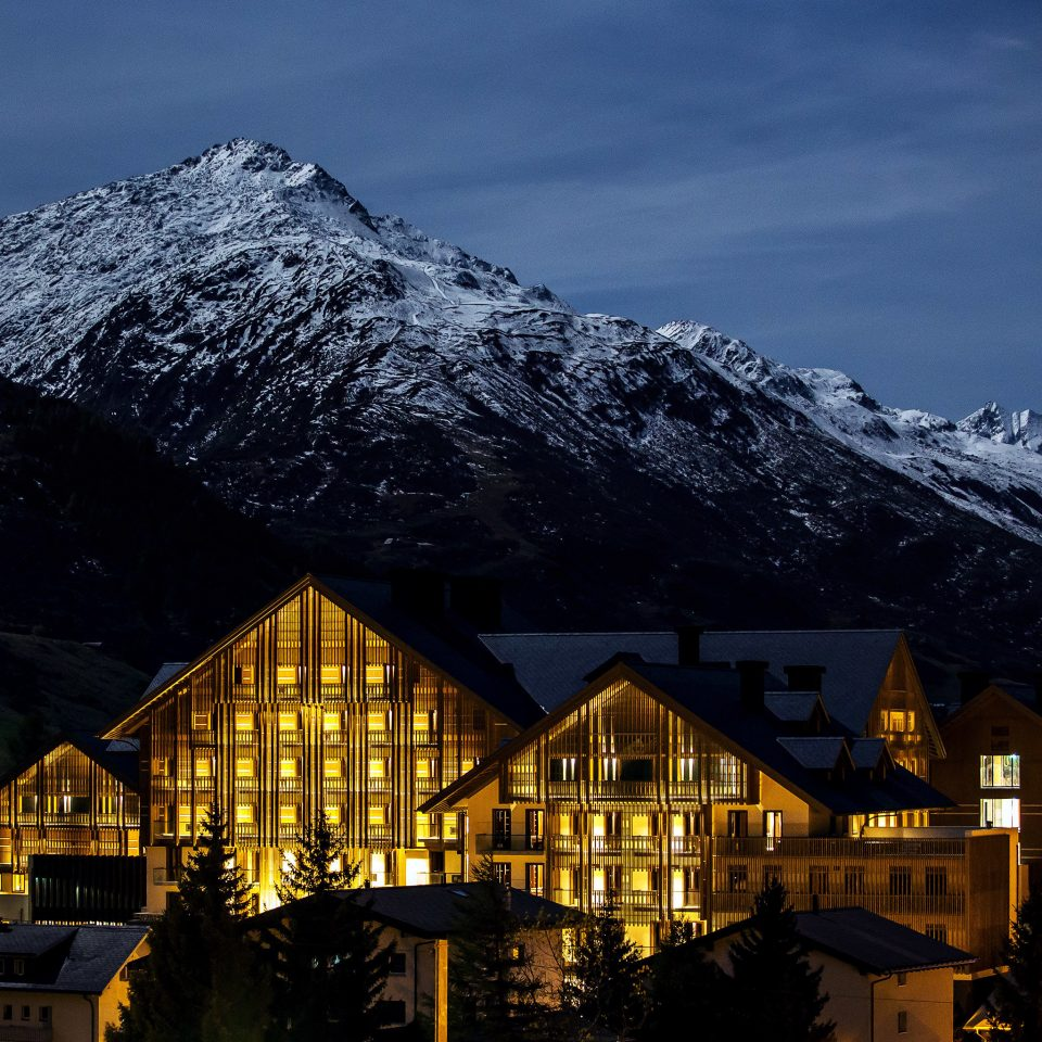 Architecture Buildings Exterior Luxury Mountains Outdoors Resort snow mountain sky mountainous landforms mountain range Winter tree night Town weather house season evening alps dusk