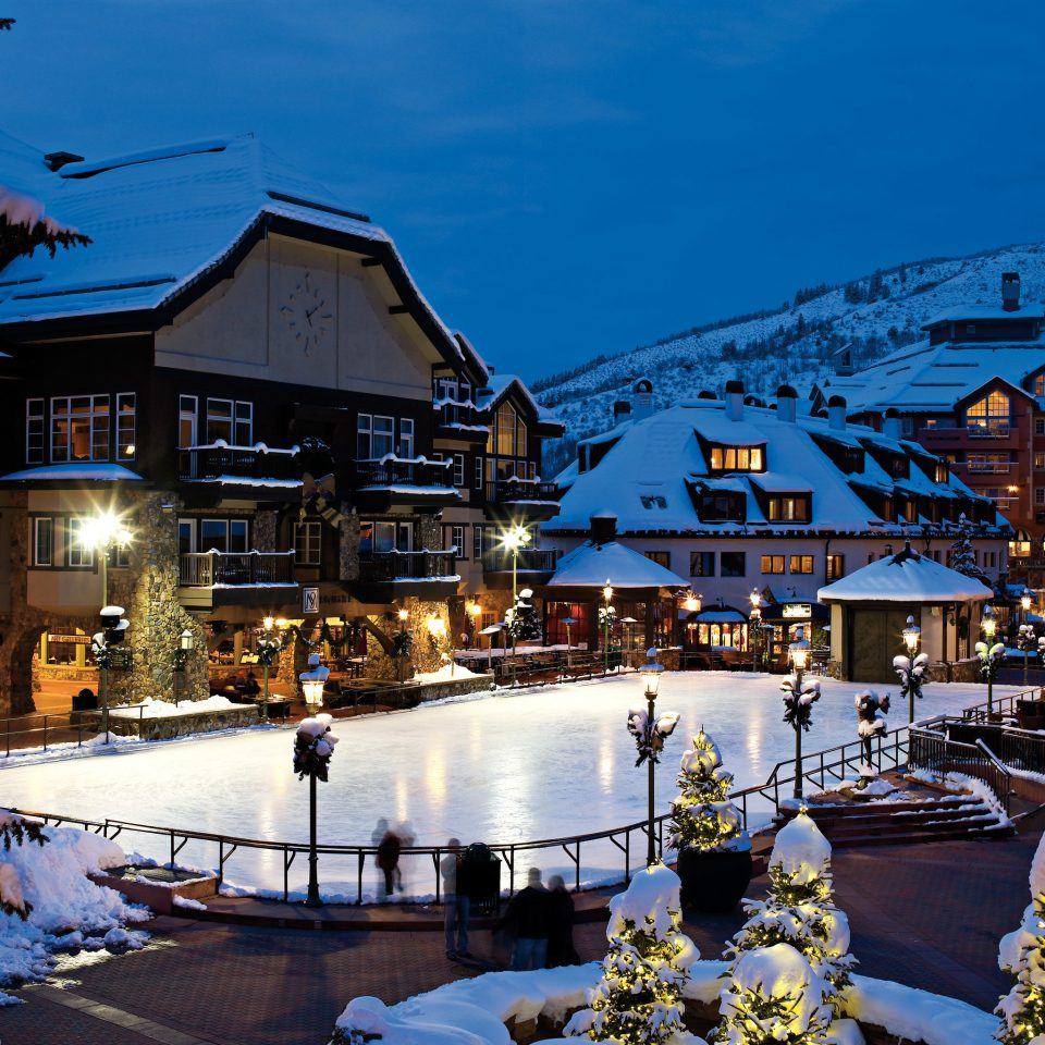 Architecture Buildings Exterior Mountains Outdoor Activities Scenic views sky Town snow Resort Winter night evening cityscape