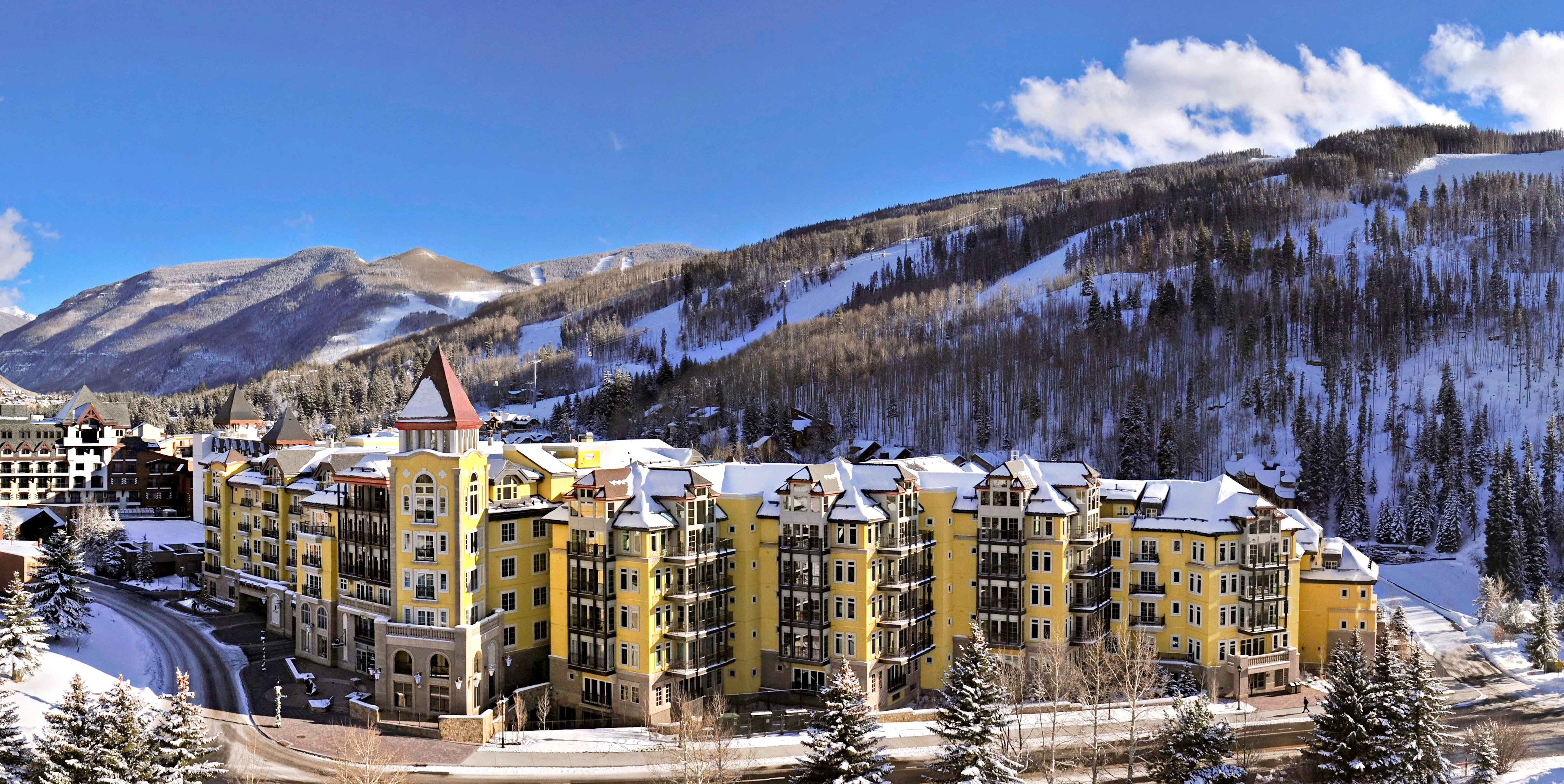 Architecture Buildings Exterior Mountains Resort Scenic views sky snow mountain Winter weather season mountain range yellow Nature piste panorama