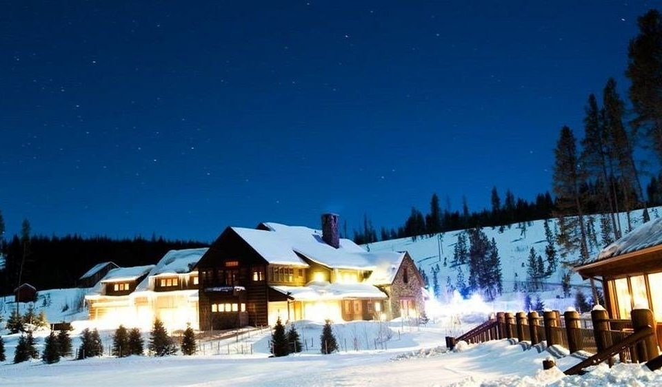 Architecture Buildings Exterior Nature Outdoors Ranch Resort snow tree sky Winter weather night season mountain range piste house slope
