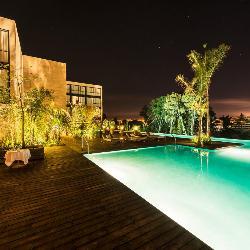 Architecture Buildings Exterior Outdoors Play Pool Resort swimming pool night light house home landscape lighting condominium mansion