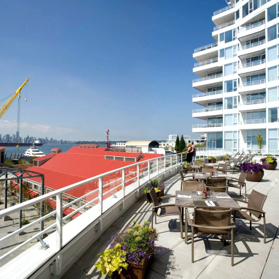 Architecture Buildings Exterior Patio Resort Waterfront walkway marina dock condominium boardwalk vehicle waterway