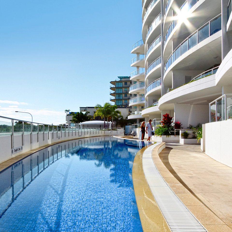 Buildings Exterior Play Pool Resort leisure building swimming pool walkway Architecture condominium boardwalk