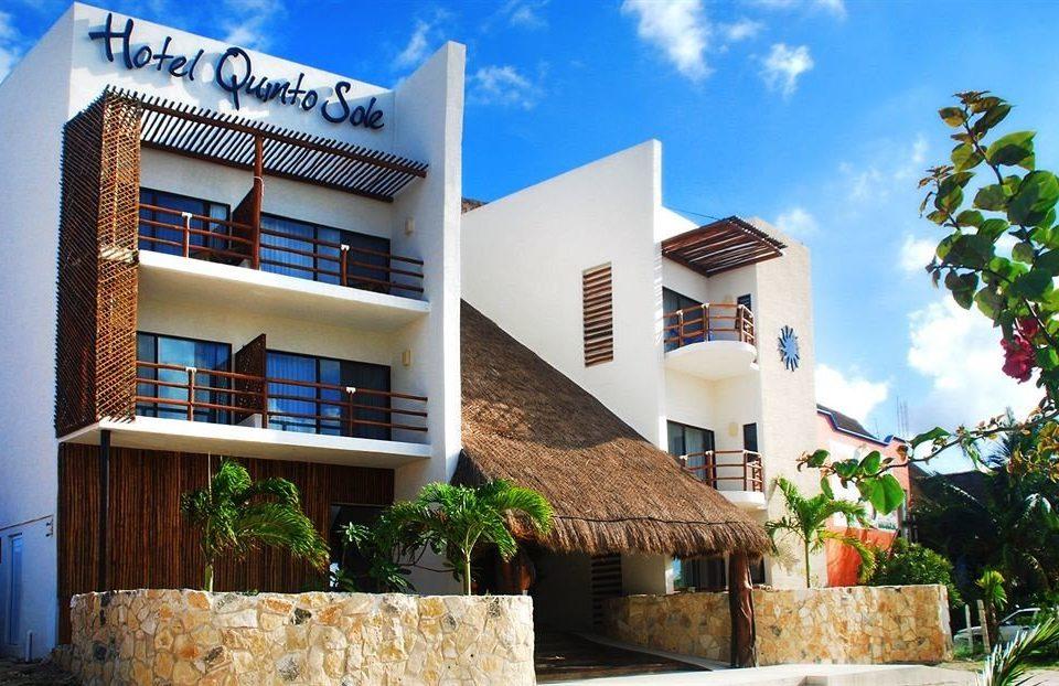 Buildings Exterior Rustic Tropical sky property house condominium Architecture Resort home Villa residential area