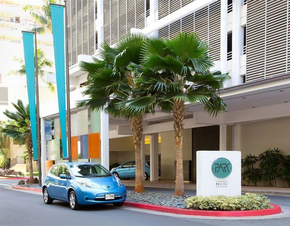 Architecture Buildings Exterior Resort tree road car condominium street vehicle arecales home