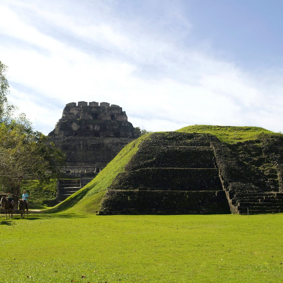 Architecture Buildings Outdoor Activities Outdoors Ruins Scenic views Sport grass tree sky field archaeological site green hill monument maya civilization rural area grassy landscape agriculture ancient history plateau mound lush day