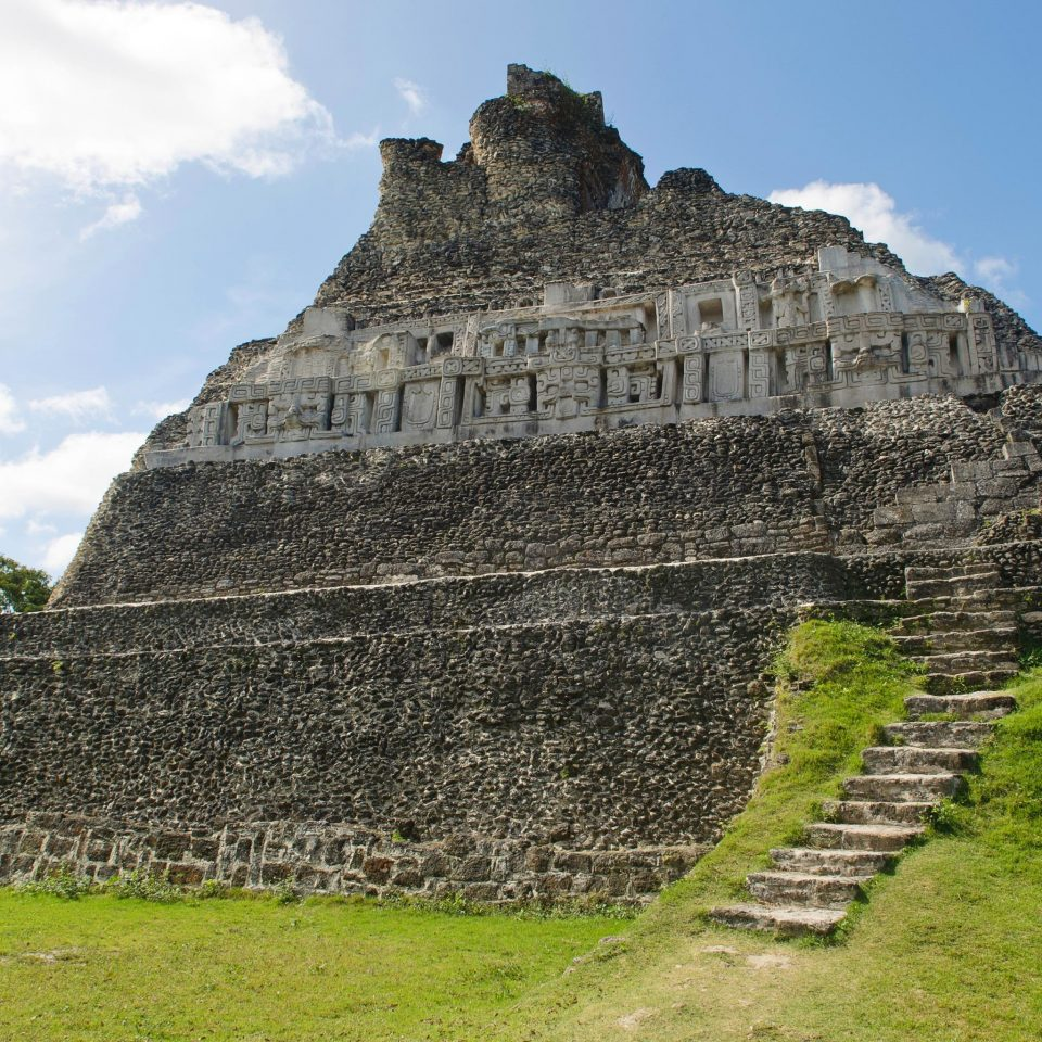 Architecture Buildings Outdoors Ruins Scenic views grass sky maya civilization building historic site archaeological site landmark monument ancient history rock fortification unesco world heritage site temple stone lush