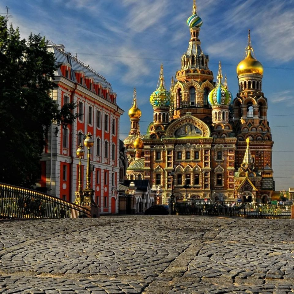 ground landmark Town cityscape City night Architecture cathedral yellow evening place of worship street Church town square stone