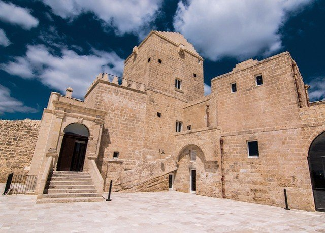 sky building Architecture ancient history Church place of worship fortification monastery brick Ruins spanish missions in california history old stone