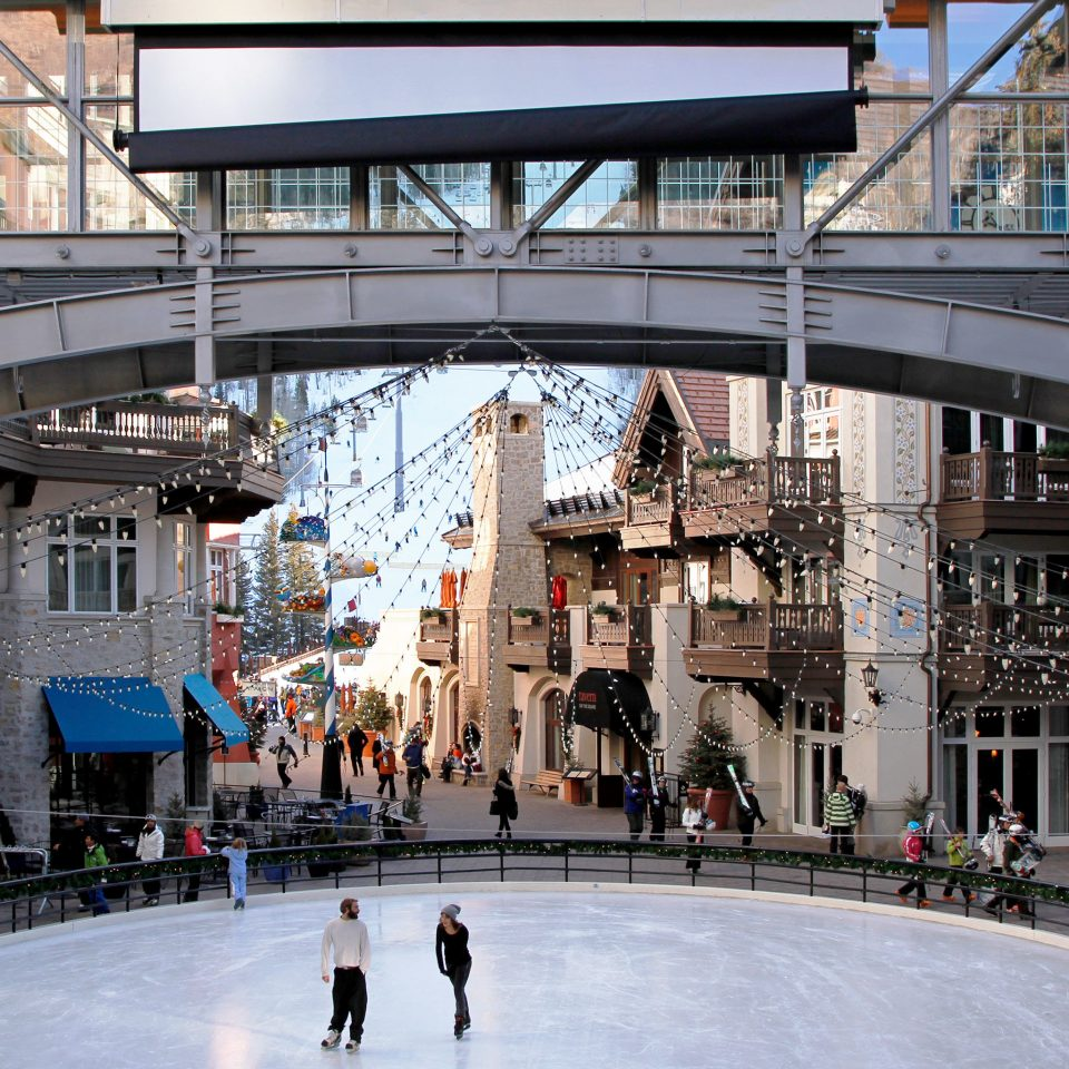 Drink Eat Luxury Resort Shop Ski building transport structure City Architecture public transport shopping mall sport venue Downtown ice rink vehicle town square