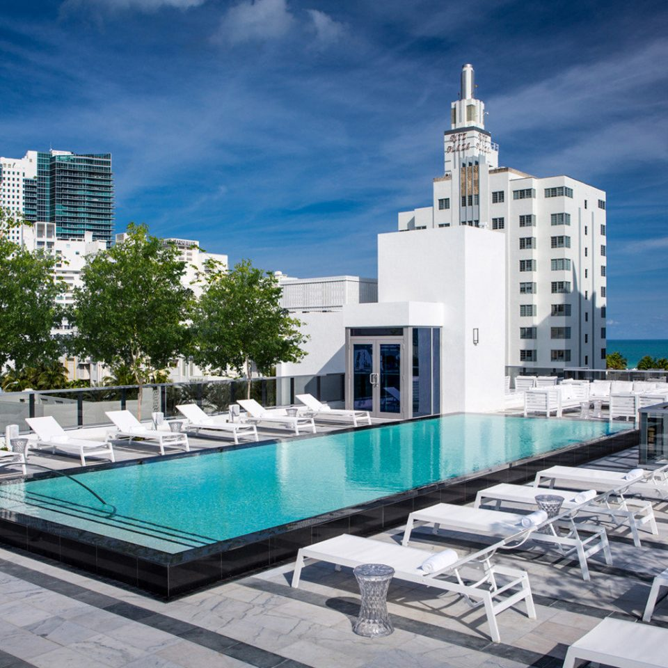 Elegant Hip Lounge Patio Pool Rooftop Terrace condominium landmark City marina skyline Architecture plaza dock skyscraper tower block Downtown cityscape metropolis urban design headquarters Harbor