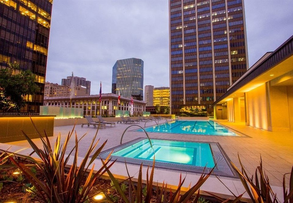 Exterior Hot tub/Jacuzzi Lounge Pool building City condominium Architecture Downtown evening cityscape skyline skyscraper yellow Resort colorful plaza