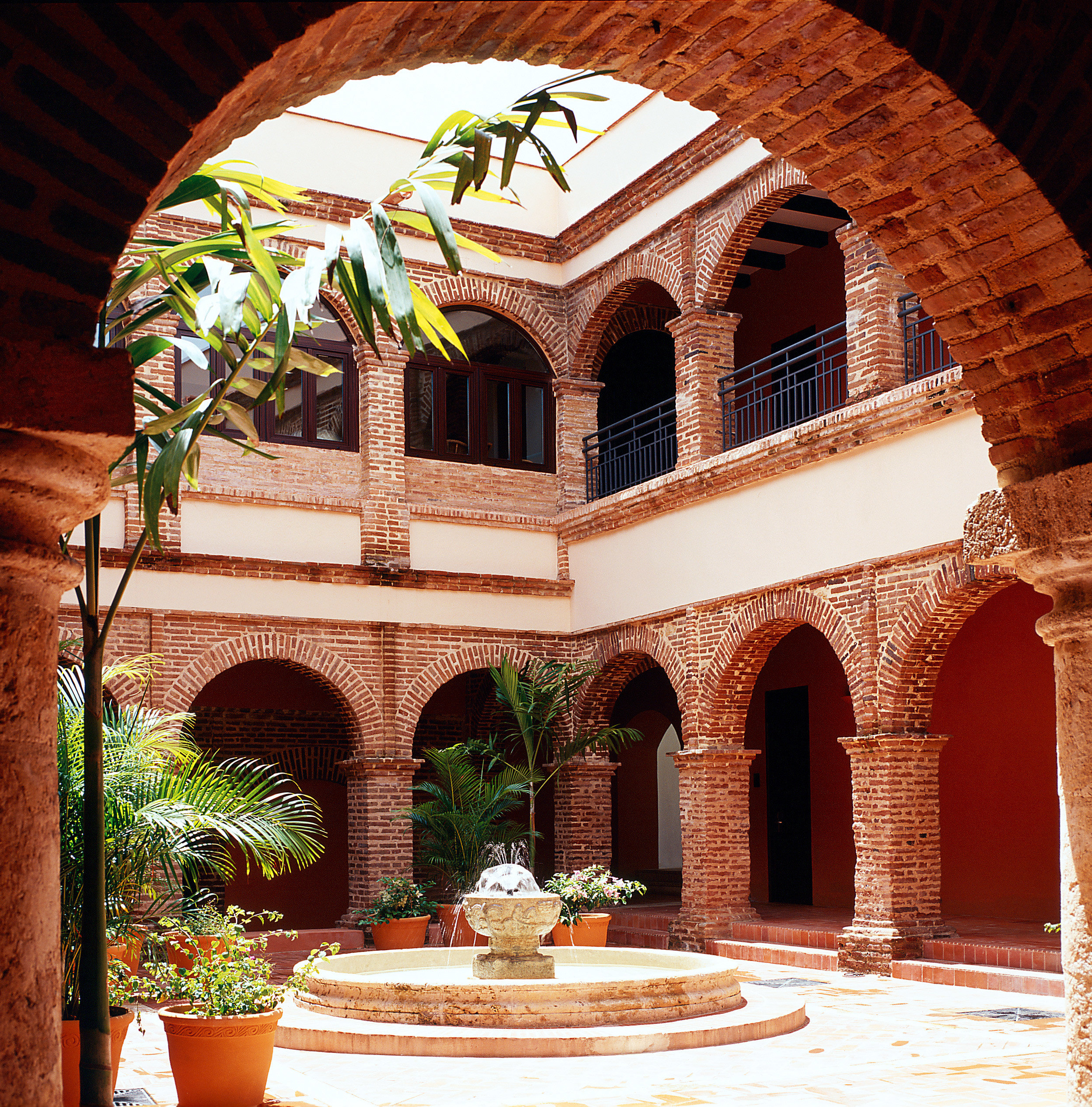Classic Courtyard Grounds building arch Architecture hacienda stone brick home mansion palace ancient history court colonnade