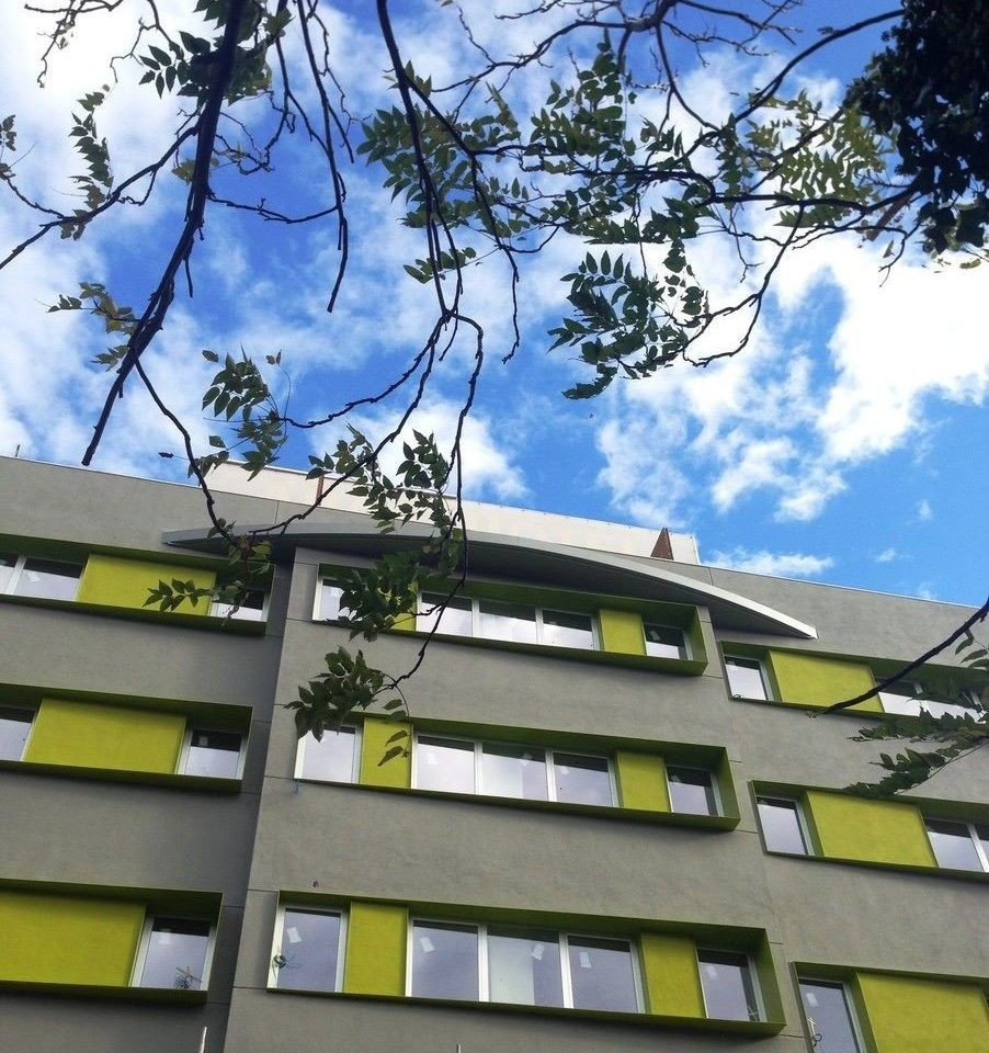 tree sky property residential area neighbourhood condominium house Architecture home tower block suburb tall roof
