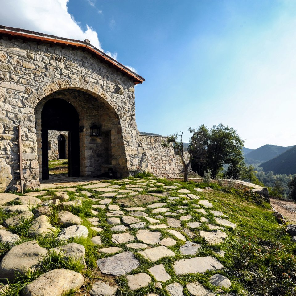 Architecture Country Grounds Historic Honeymoon Romance Romantic Rustic Villa Wellness sky rock stone building mountain Ruins old monastery rural area ancient history brick rocky fortification chapel Village place of worship arch