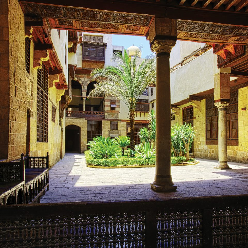 Courtyard building Architecture street home ancient history mansion palace alley restaurant stone walkway colonnade arch