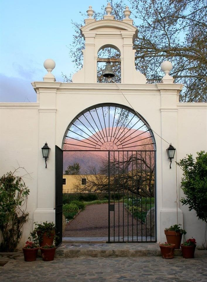 tree arch building Architecture house gate chapel hacienda home Courtyard door stone colonnade